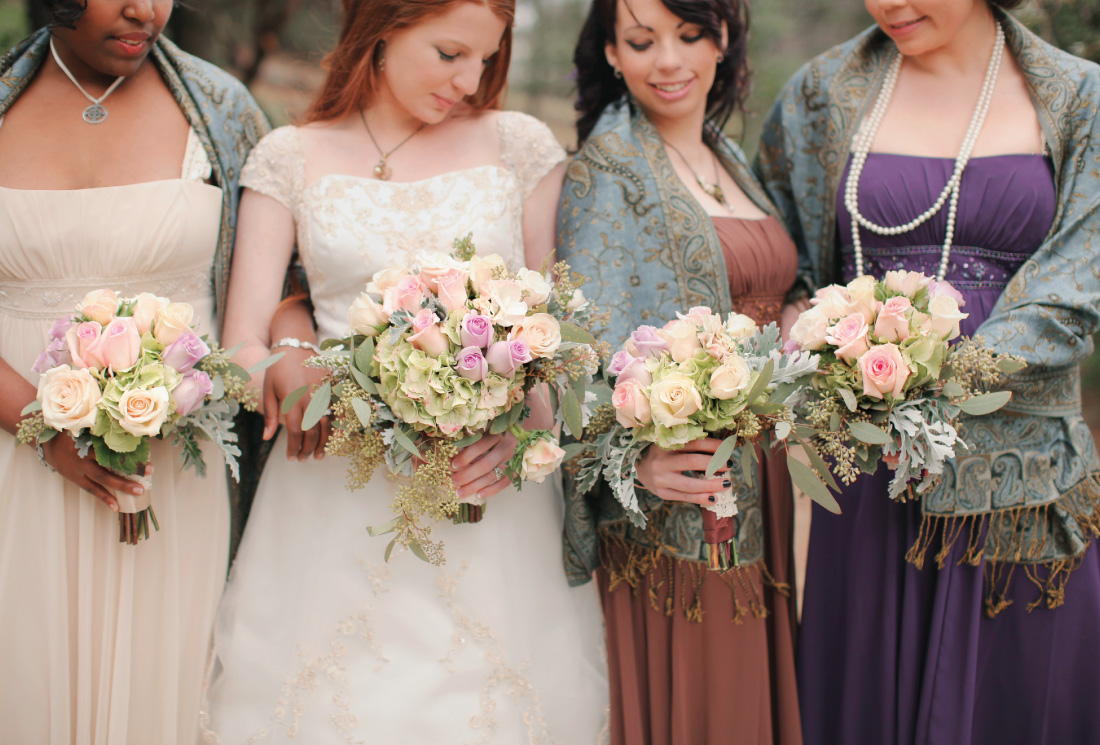 bride and bridesmaids portrait with bouquets