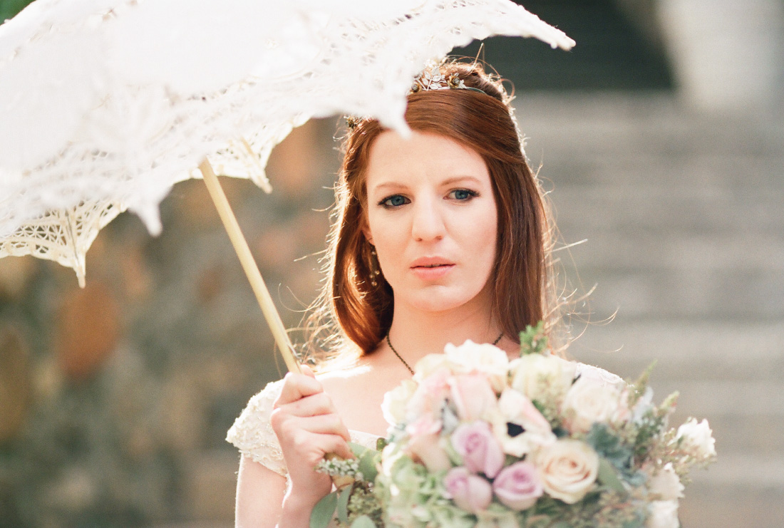 bride with a parasol in bright light