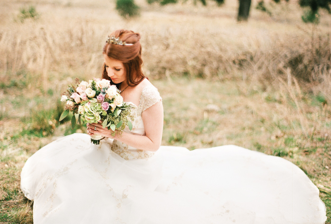 bride portrait in a meadow with a bouquet