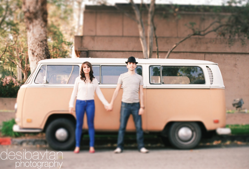 couple in front of a volkswagen type 2 kombi transporter