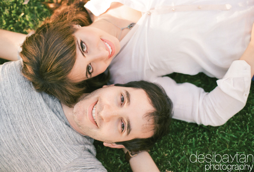 couple lying on the grass looking up
