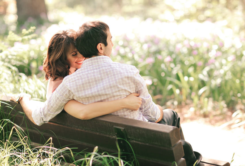 couple on park bench snuggling